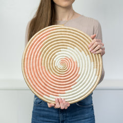 "Model holding the 14"" Zera Flat in Blush."