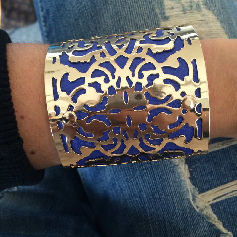 Jocelyn Cuff in navy blue being worn with denim jeans