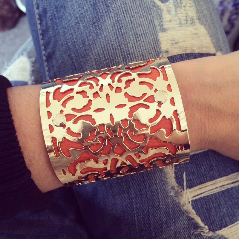 Jocelyn Cuff in orange being worn with denim jeans