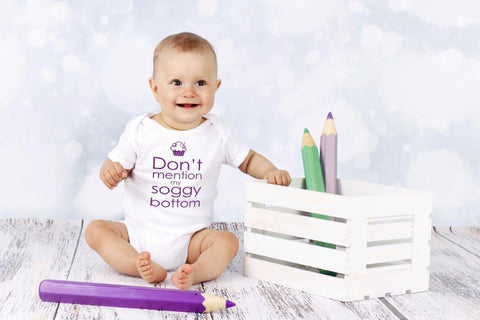 'Don't mention my soggy bottom' short-sleeved baby vest