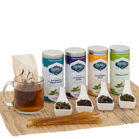 It's a Tea Party Gift Set - Four Elegant Tins with Tea Filters and Honey Sticks