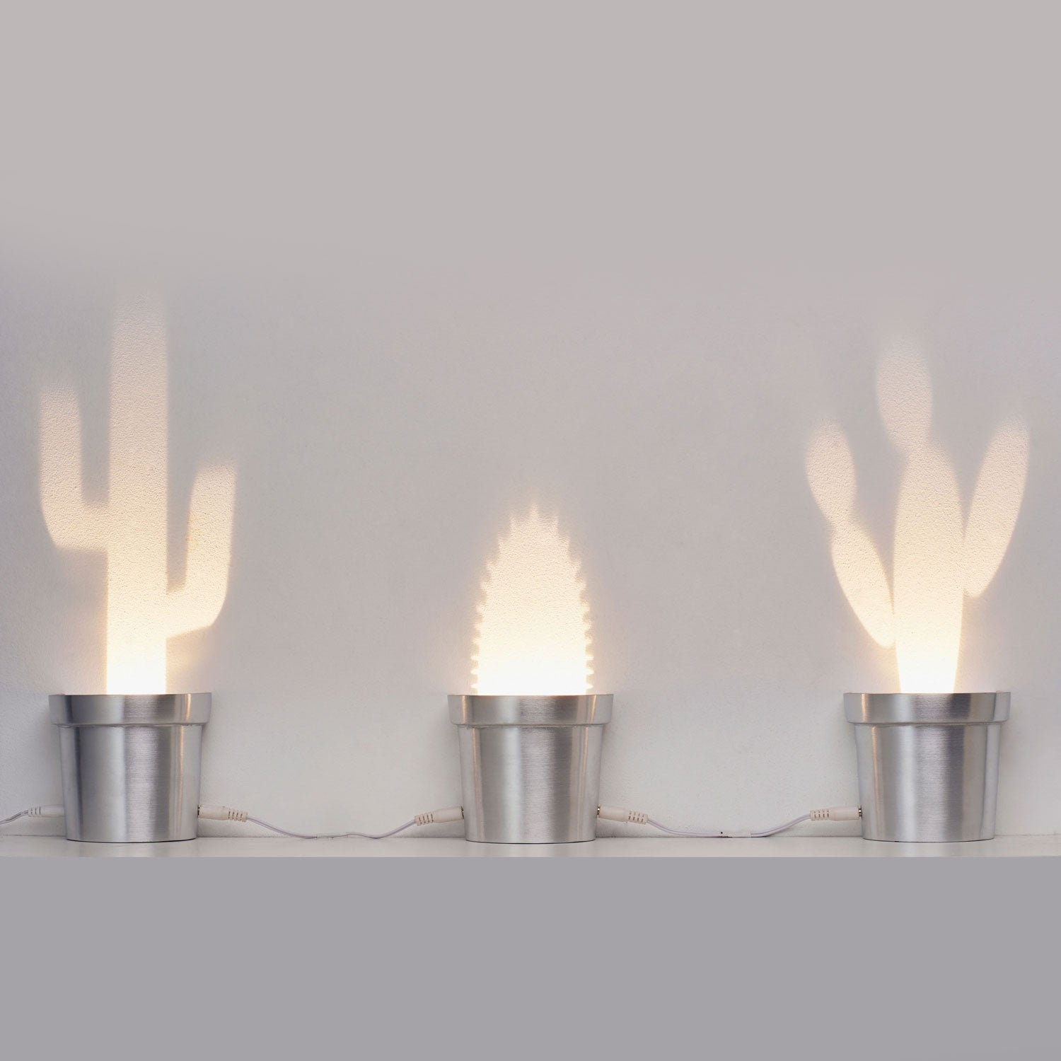 A Set of Three Cactus Lamps in Three Different Shapes Made Aluminum