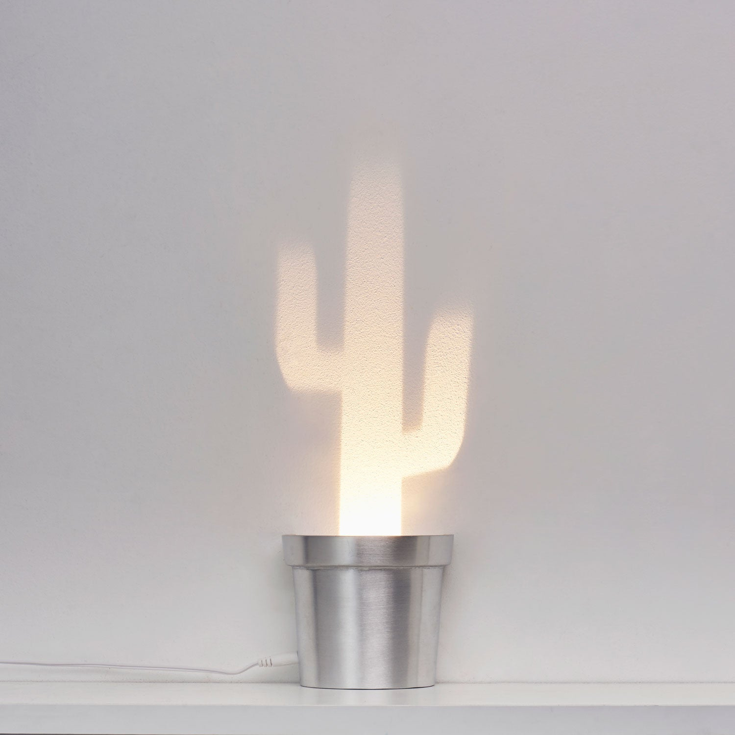 A Single Lamp Made Aluminum Containing 3 Different Cactus Shapes