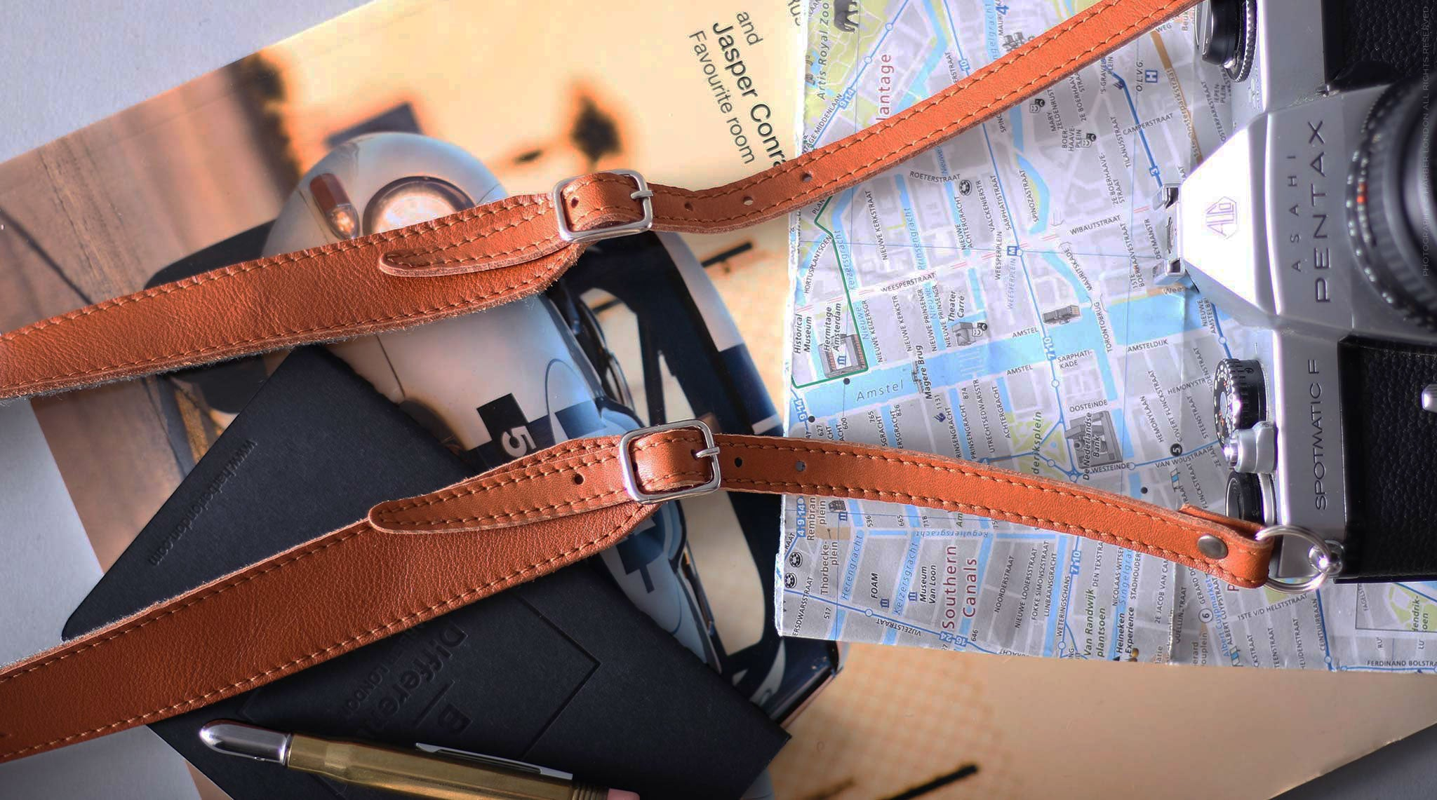 Ajustable leather camera strap