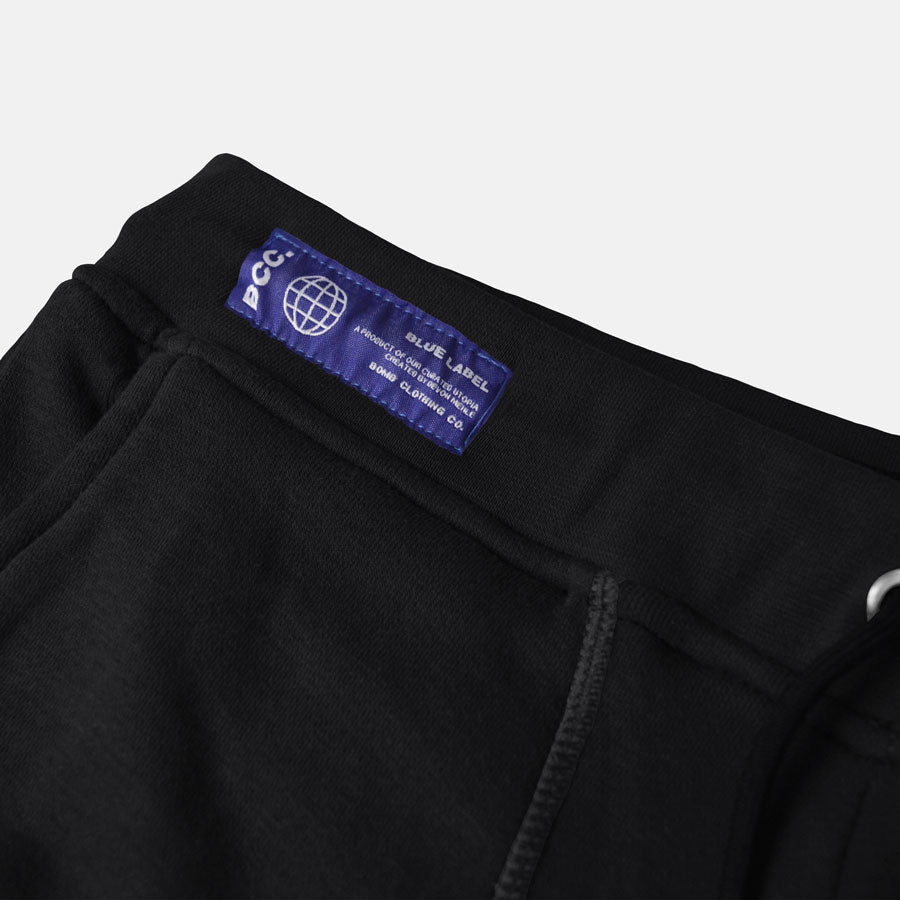 Detail shot of Blue Label on waistband