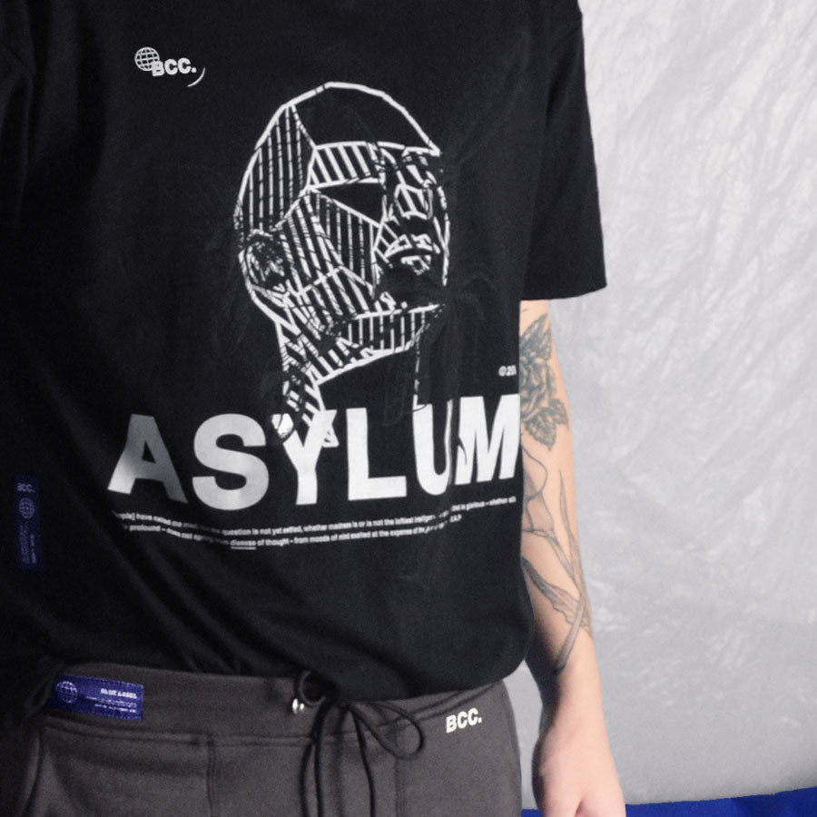 Closeup of a model wearing the Asylum tshirt in black