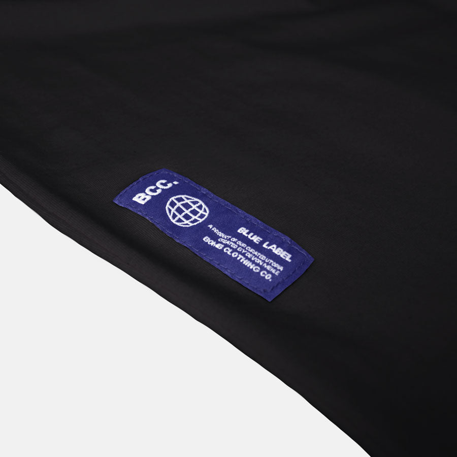 Detail shot of Blue Label on black shirt