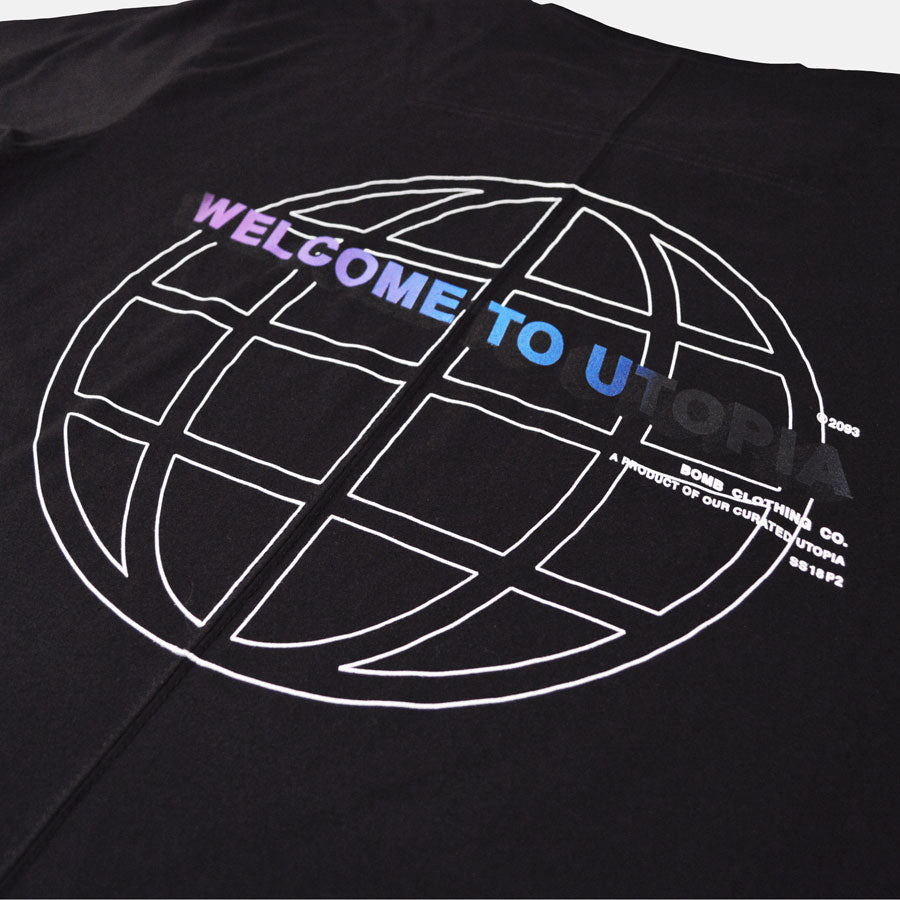 Closeup of Welcome to Utopia screen print on back of black tshirt