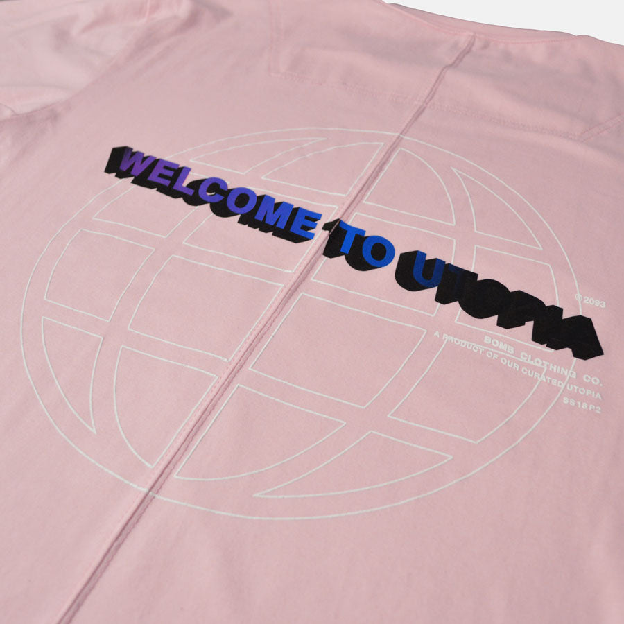Closeup of Welcome to Utopia screen print on back of a soft pink tshirt
