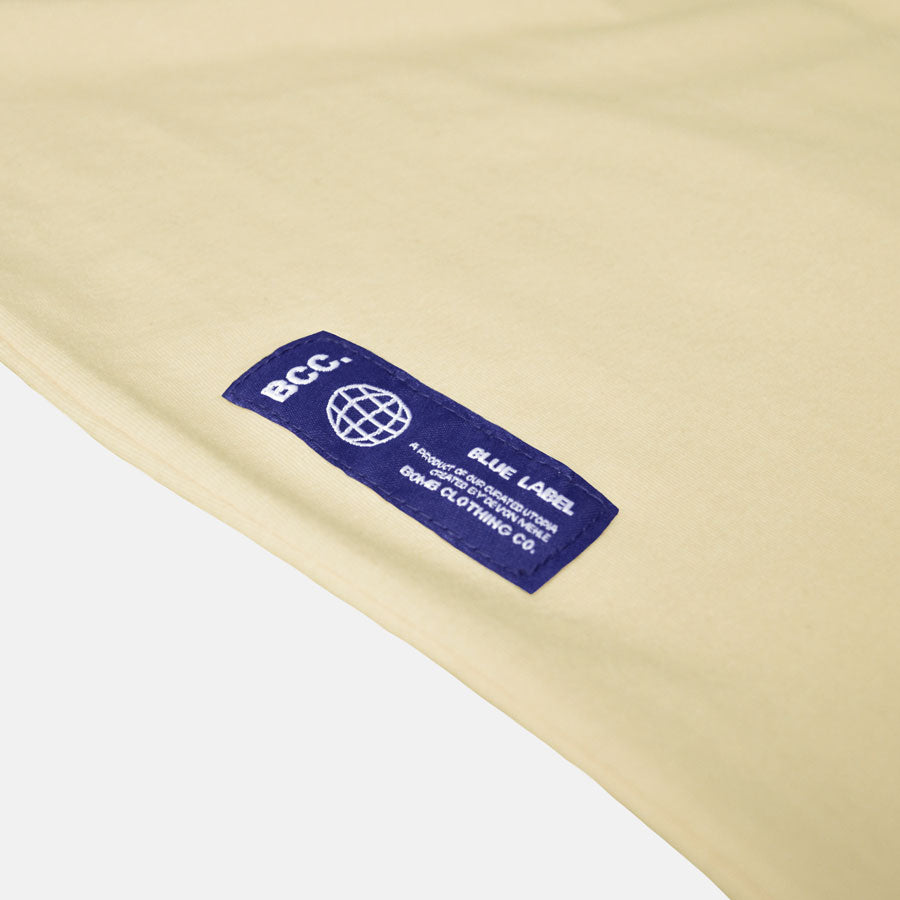 Blue label on soft yellow tshirt