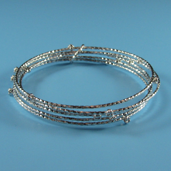 4531 - 5 Glistening Diamond Cut Bangles with Diamond Cut Bead Stations