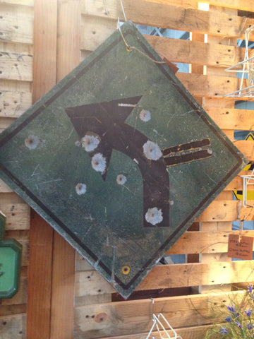 Arrow sign with Bullet holes