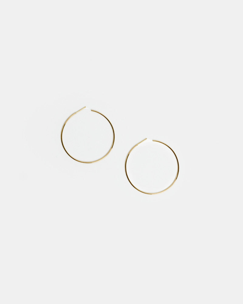 Thread Arc Hoops in 14k Gold by Kristen Elspeth at Mohawk General Store