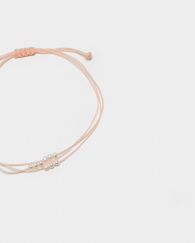 Wish Me Luck Pearl Cord Bracelet in Baby Pink