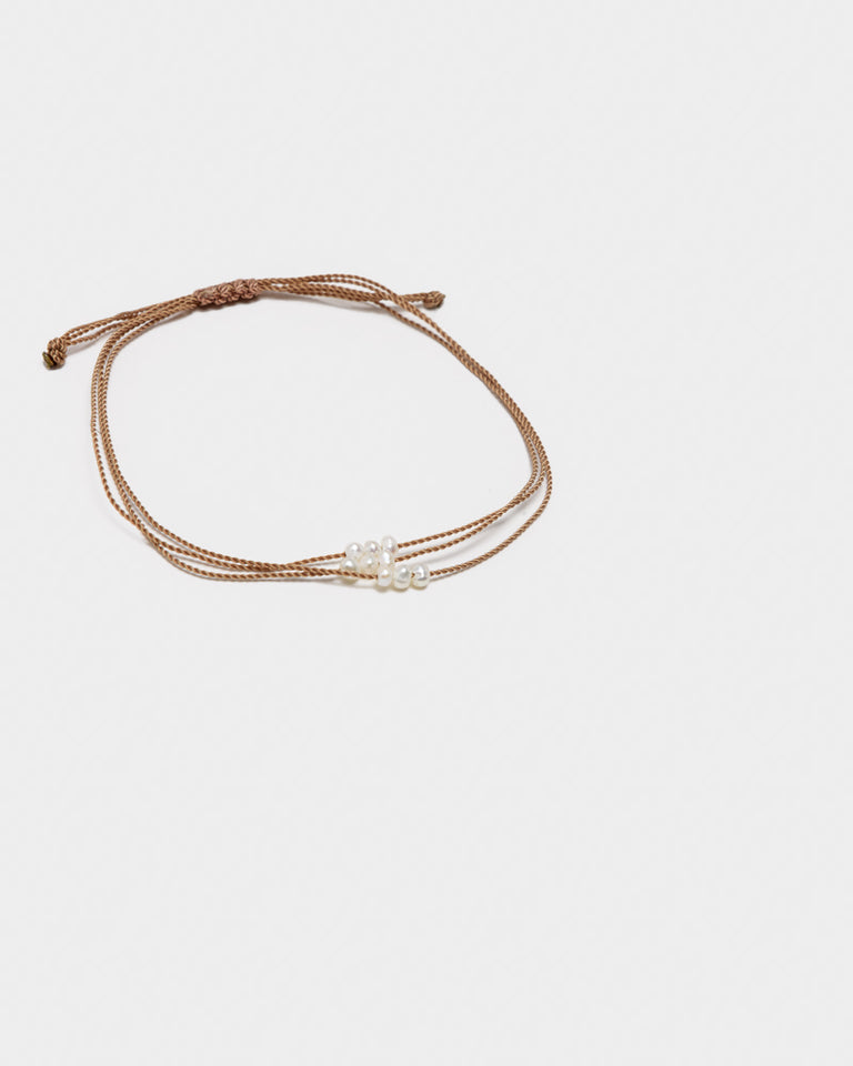 Wish Me Luck Pearl Cord Bracelet in Tan