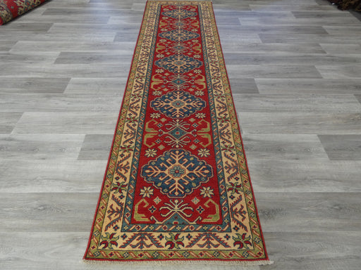 Afghan Hand Knotted Kazak Runner Size: 300 x 83cm