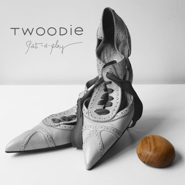 Luxury shoes with single wooden baby toy