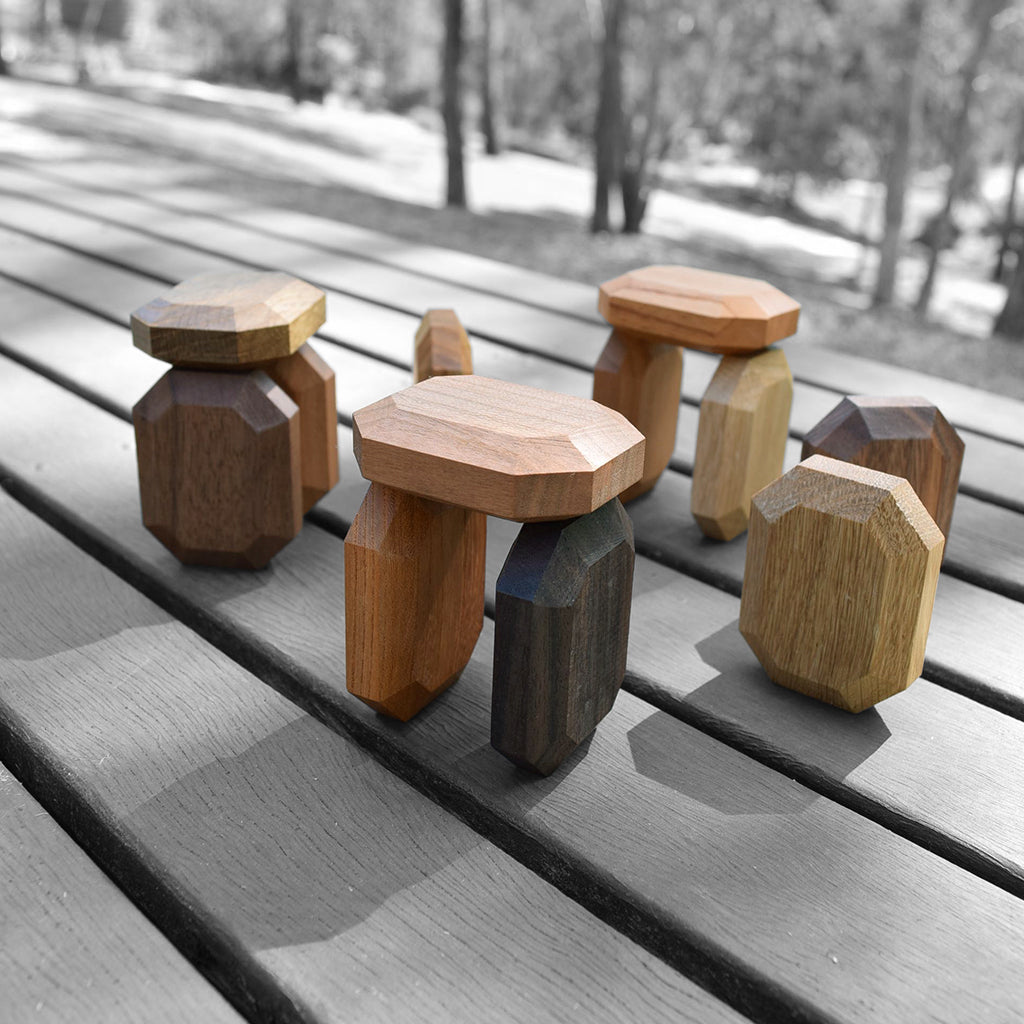 Twoodie wooden baby toys in stone henge shapes outside