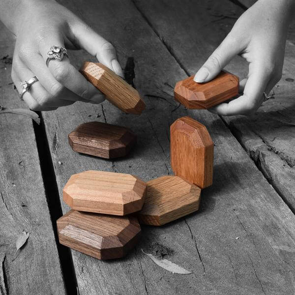 organic wooden blocks in hands