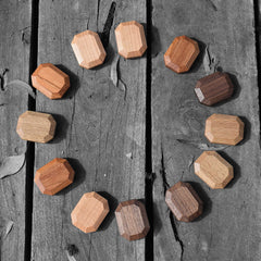 Twoodie wooden stacking blocks set of 12 in 4 types of wood in a circle arrangement