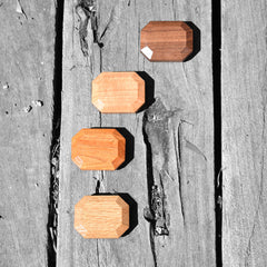 aerial view of four types of wooden gems blocks on wood slate