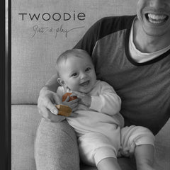 father and daughter play and smile with wooden gem toy