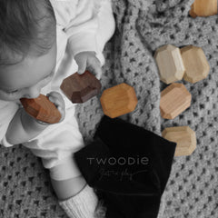 Baby teething and playing with chemical free wooden blocks