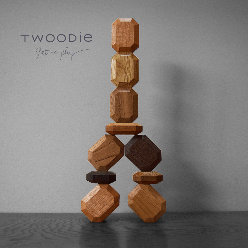 wooden stacking gems by twoodie arranged as a tower