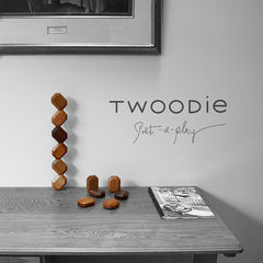 twoodie art toys on desk with new york magazine and painting