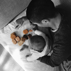 Father and baby playing with organic wooden blocks that are endocrine disruption free and safe
