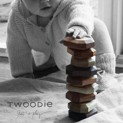 toddler stacks wooden gem blocks high