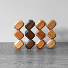 4 types of organic wood blocks stacked in a surrealist way