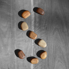S shape of pebbles created by natural wood round shapes