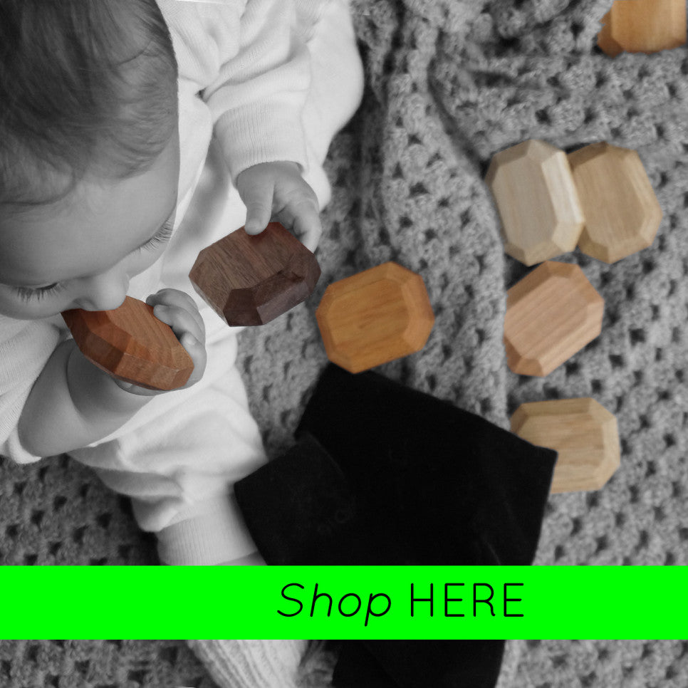 Baby playing and teething on a twoodie organic baby toy