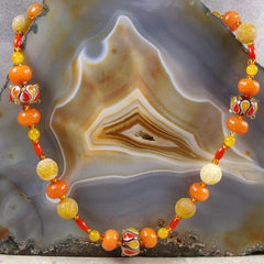 long orange gemstone necklace with glass beads