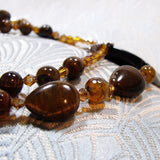 detail for tigers eye neckace