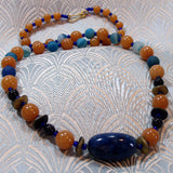 handcrafted blue orange necklace with semi-precious beads