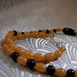 orange black semi-precious stones