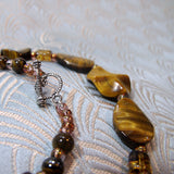 detail for necklace handmade from tigers eye