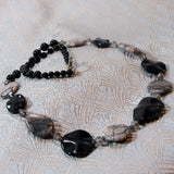 unique grey black necklace design
