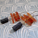 orange long black earrings with statement
