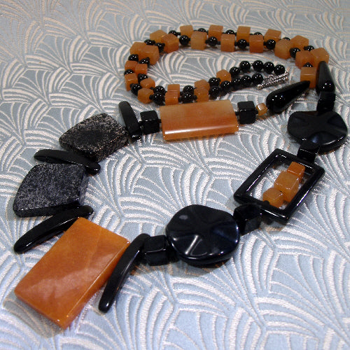 long orange black necklace, long statement necklace, semi-precious stone jewellery