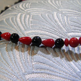 red black beads