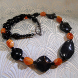 unique black orange necklace