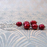 long cranberry coloured pearl earrings