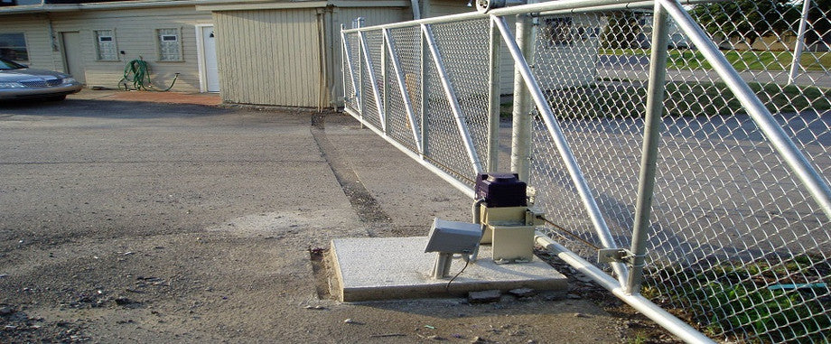 TC-9 sliding gate opener installed on a storage facility