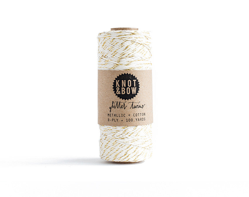 100 yards of glitter bakers twine by Knot & Bow. Durable 8 ply blend of natural botton twine with gold filament. Adds a twinkle to gift wrapping.