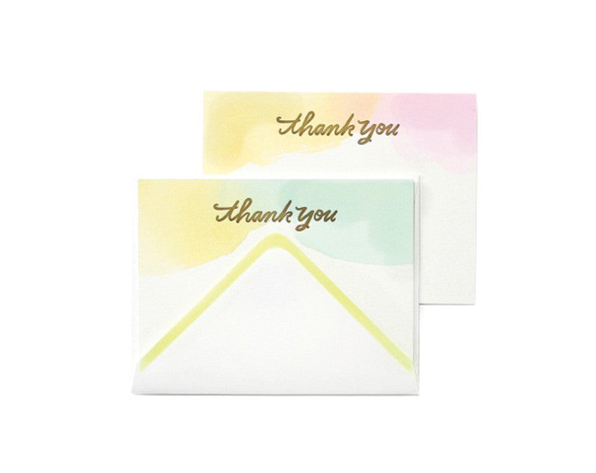 Watercolour style card set with 'thank you' in script type. Letterpress printed, blank inside with a matching envelope and neon yellow trim. Set of 12. By Moglea.