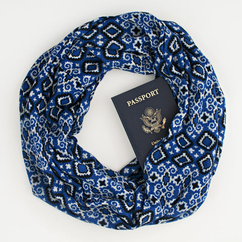 The Tuilieres (Blue) Speakeasy Travel Supply hidden-pocket scarf.