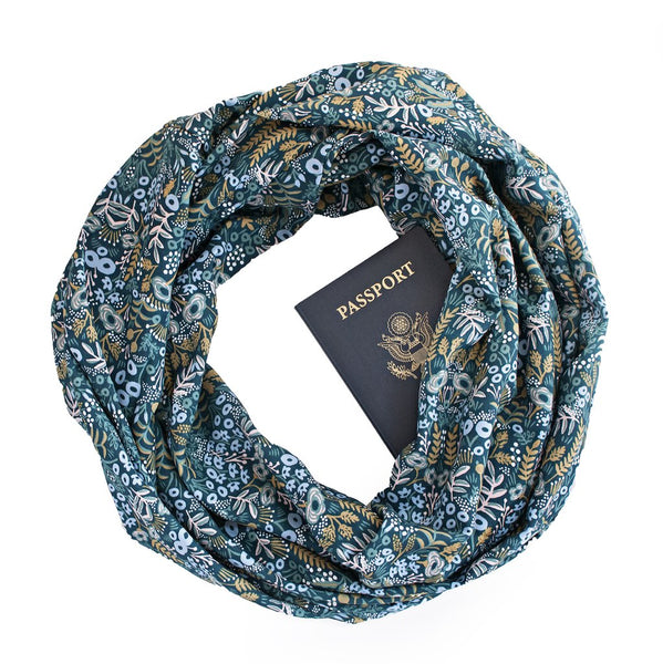 A floral print rayon secret pocket travel scarf.